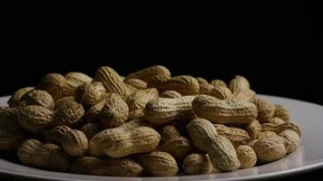 Cinematic, rotating shot of peanuts on a white surface - PEANUTS 026