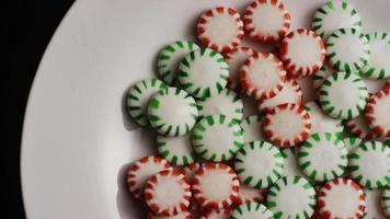 Rotating shot of spearmint hard candies - CANDY SPEARMINT 075