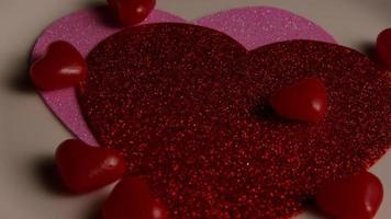 Rotating stock footage shot of Valentines decorations and candies - VALENTINES 0112