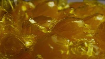 Rotating shot of butterscotch candies - CANDY BUTTERSCOTCH 030