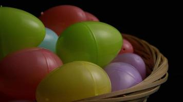Rotating shot of Easter decorations and candy in colorful Easter grass - EASTER 033 video