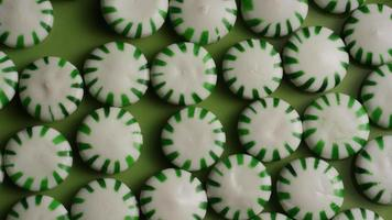 Rotating shot of spearmint hard candies - CANDY SPEARMINT 022