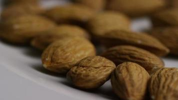 Cinematic, rotating shot of almonds on a white surface - ALMONDS 015