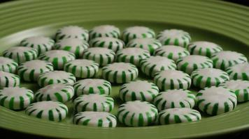 Rotating shot of spearmint hard candies - CANDY SPEARMINT 033