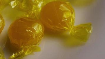 Rotating shot of butterscotch candies - CANDY BUTTERSCOTCH 009