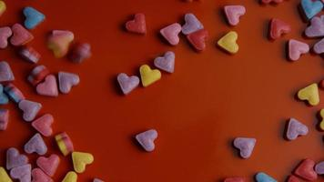 Rotating stock footage shot of Valentines decorations and candies - VALENTINES 0083