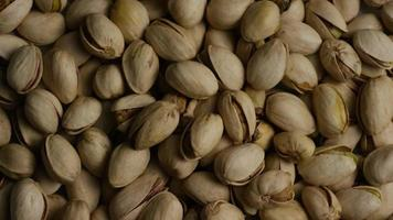Cinematic, rotating shot of pistachios on a white surface - PISTACHIOS 028