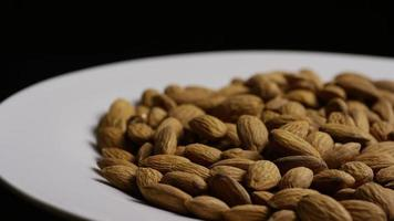 Cinematic, rotating shot of almonds on a white surface - ALMONDS 035