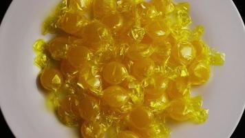Rotating shot of butterscotch candies - CANDY BUTTERSCOTCH 016