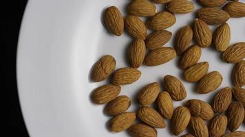 Cinematic, rotating shot of almonds on a white surface - ALMONDS 002