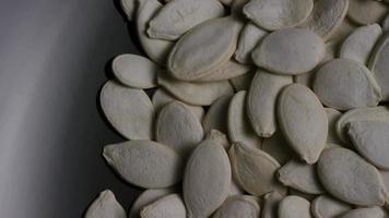 Cinematic, rotating shot of pumpking seeds - PUMPKIN SEEDS 027