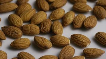 Cinematic, rotating shot of almonds on a white surface - ALMONDS 008
