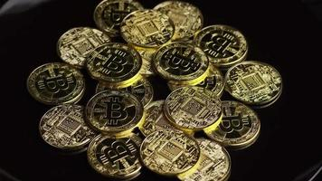 Rotating shot of Bitcoins (digital cryptocurrency) - BITCOIN 0586