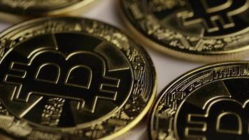 Rotating shot of Bitcoins (digital cryptocurrency) - BITCOIN 0270