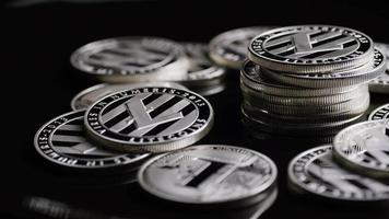Rotating shot of Bitcoins (digital cryptocurrency) - BITCOIN LITECOIN 378