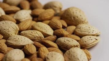 Cinematic, rotating shot of almonds on a white surface - ALMONDS 179