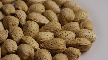 Cinematic, rotating shot of almonds on a white surface - ALMONDS 069