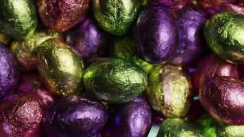 Rotating shot of colorful Easter candies on a bed of easter grass - EASTER 229 video