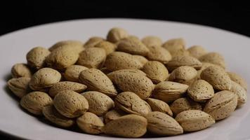 Cinematic, rotating shot of almonds on a white surface - ALMONDS 153