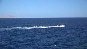 Yacht sailing on opened sea.