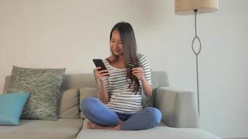 Women using phone on sofa video