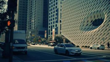 Horizontal panning shot of stop light and crosswalk at downtown of Los Angeles in 4K video