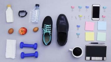 Objects for exercising and office coming on gray background.