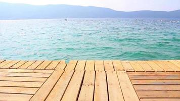 Green Wooden Pier And Calm Turquoise Sea video