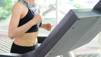 Asian sportswoman running on a treadmill