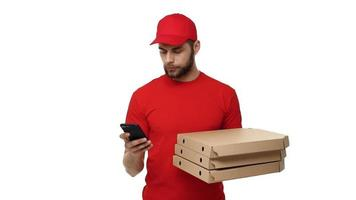 Delivery man holding a stack of pizza boxes