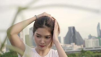 Young Asian woman fixing her hair video