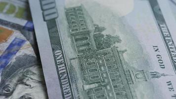 Rotating stock footage shot of $100 bills - MONEY 0132