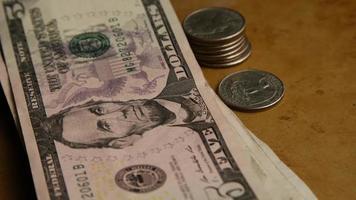 Disparo giratorio de dinero americano (moneda) - dinero 556