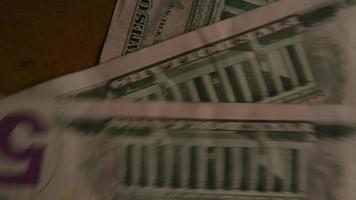 Disparo giratorio de dinero americano (moneda) - dinero 458