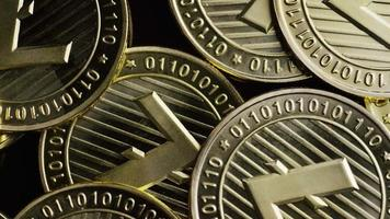 Rotating shot of Bitcoins (digital cryptocurrency) - BITCOIN LITECOIN 232