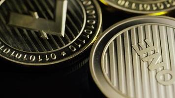 Rotating shot of Bitcoins (digital cryptocurrency) - BITCOIN LITECOIN 287