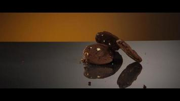 Falling cookies from above onto a reflective surface - COOKIES 203 video