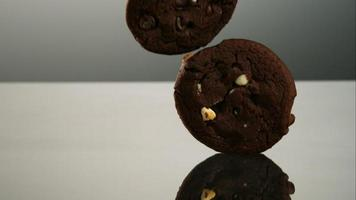 Cookies falling and bouncing in ultra slow motion (1,500 fps) on a reflective surface - COOKIES PHANTOM 079 video