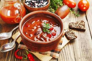 Chili soup with red beans and greens photo