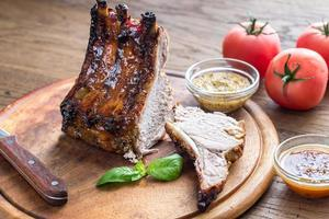 Grilled pork ribs in barbecue sauce photo