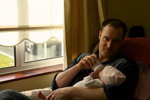new generation of father breastfeeding newborns