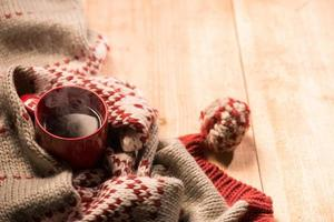 Holiday woven clothing and coffee in cold winter photo
