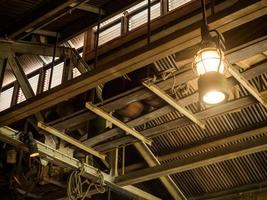 Vintage old latern lamp in barn photo