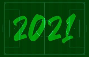 2021 happy new year football field greeting card with lettering. Creative football soccer field background for Christmas and New Year celebration. Sport greeting card
