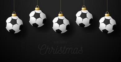 Merry Christmas Football greeting card. Hang on a thread Soccer ball as a Christmas ball on black horizontal background. Sport Vector illustration.