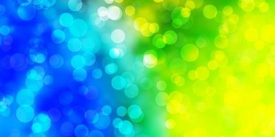 Fondo de vector azul claro, verde con burbujas.