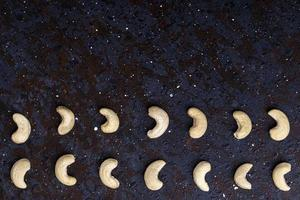 Cashew nuts on a black background with copy space