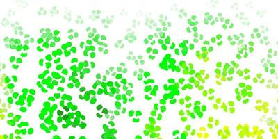 Light green, yellow vector backdrop with chaotic shapes.