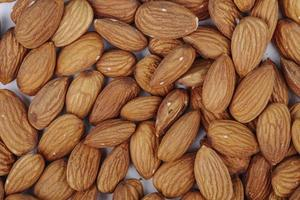 Top view of almond nuts on a white background photo
