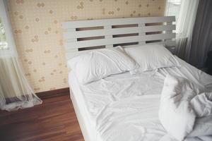 Crumpled bedsheets in the bedroom photo